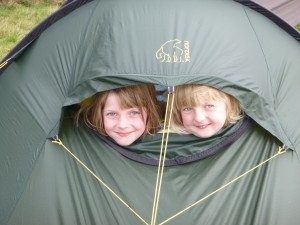 Molly and Daisy peering out of the tent.