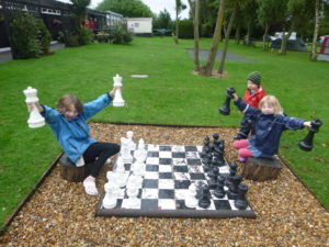 Giant chess in the rain.