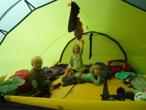 Inner tent activities listening to the summer rain fall.