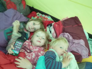 Molly, Daisy and Jack cosily cocooned in tent.
