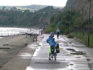 Molly dodging large puddles on the pedestrian-shared bike path to Shanklin.